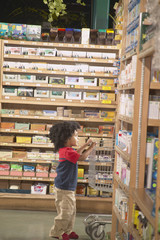 Young African American boy in health food store
