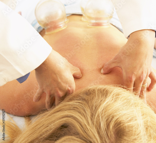 Woman receiving vacuum cupping massage treatment
