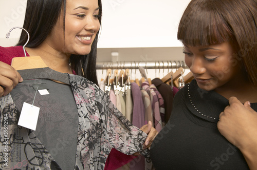 Two African American women shopping for clothes