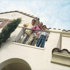 Three males standing on home balcony