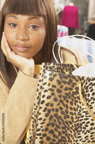 Close up of African American woman with shopping bag