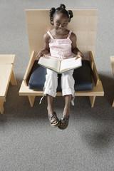 Girl holding open book