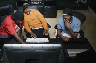 Men working on computer together