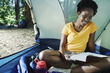 Woman sitting in tent