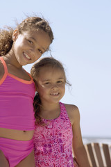 Portrait of sisters at beach