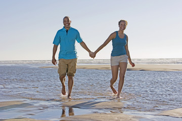 Portrait of couple holding hands at beach