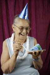 Woman eating birthday cake