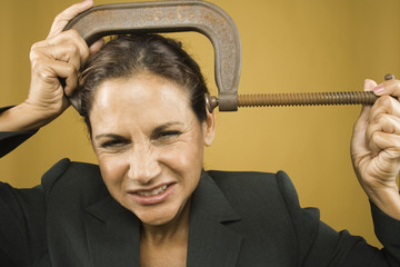 Portrait of businesswoman with clamp on head
