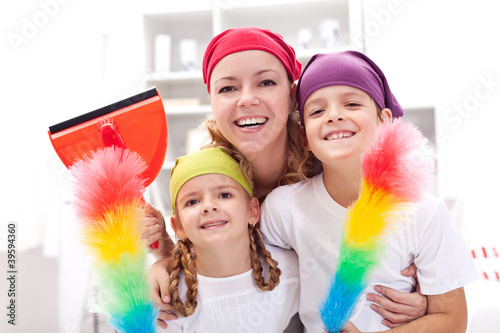 Cleaning taskforce - woman with kids tidy up