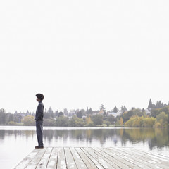 Man on dock by lake