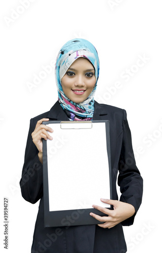 Beautiful Muslim woman holding a blank paper on file