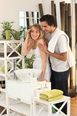 Young couple preparing in bathroom