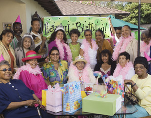Group portrait of elderly woman's birthday party