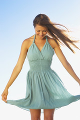 Woman holding out dress to sides
