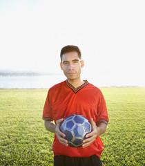 Portrait of soccer player holding ball