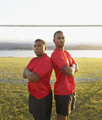 Portrait of two soccer players back to back