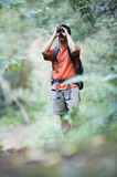 Man using binoculars while hiking