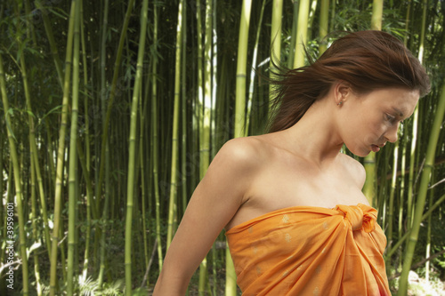 Portrait of woman with hair blowing in forest