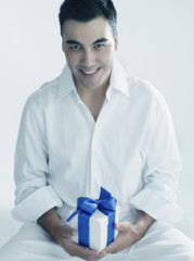 Young man holding a present