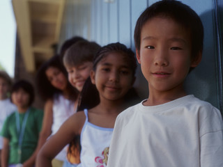 Group portrait of children standing in line