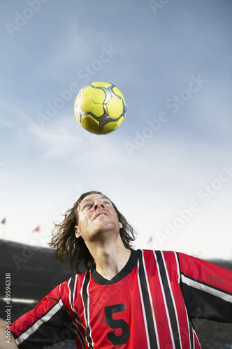 Soccer player headering the ball