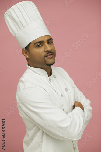 Male chef posing for the camera with arms crossed