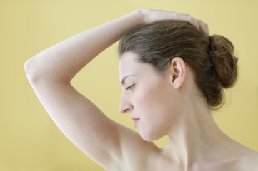 Young woman stretching her neck