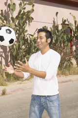 Young man playing with a soccer ball
