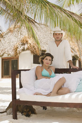 Young man and woman in tropical resort