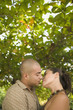 Couple kissing outdoors