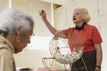 Elderly woman playing bingo