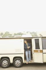 Man standing in doorway to recreational vehicle