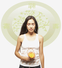 Young woman meditating with flower against Oriental background