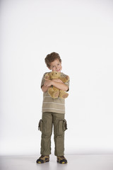 Portrait of boy hugging teddy bear