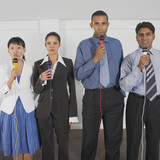 Four business people with microphones