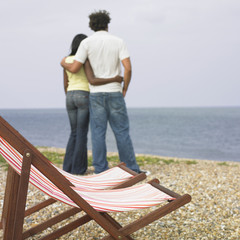 Couple hugging and looking at ocean