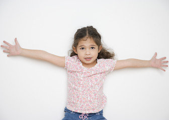 Portrait of young girl with arms spread open wide