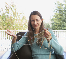 Portrait of woman with tangled knitting
