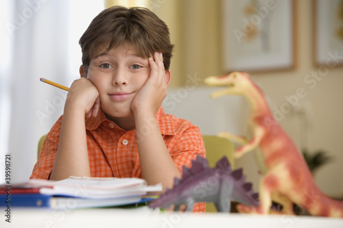 Young boy sitting at his desk