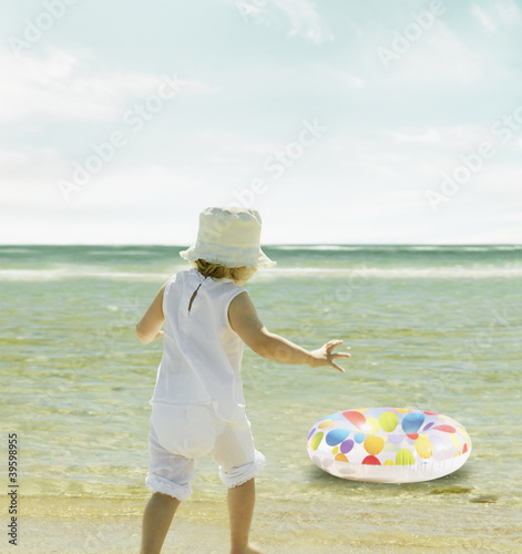 Little girl watching her inner tube float away