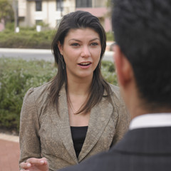 Businesswoman talking to colleagues
