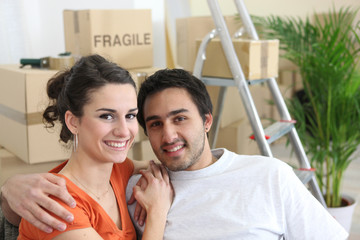 Young couple moving into first home
