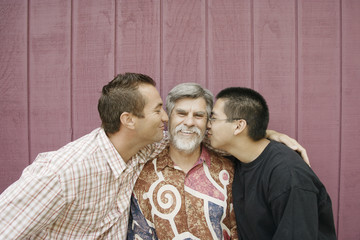 Three generations of men smiling for the camera
