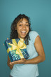 Young woman holding a wrapped present