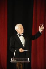 Senior man accepting an award
