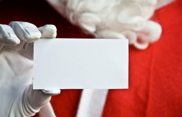 Father Christmas with clear white card for text