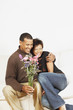 Couple holding a vase of flowers