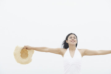 Young woman with her arms outstretched