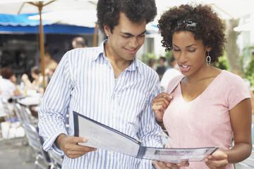 Young couple examining a menu