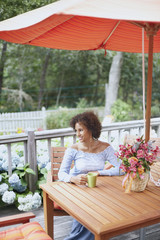 Young woman drinking a cup of coffee outdoors